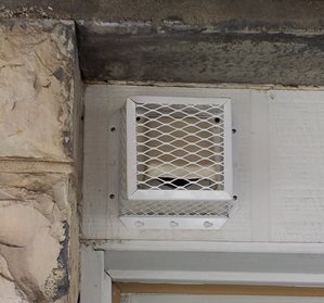 vent cover above window